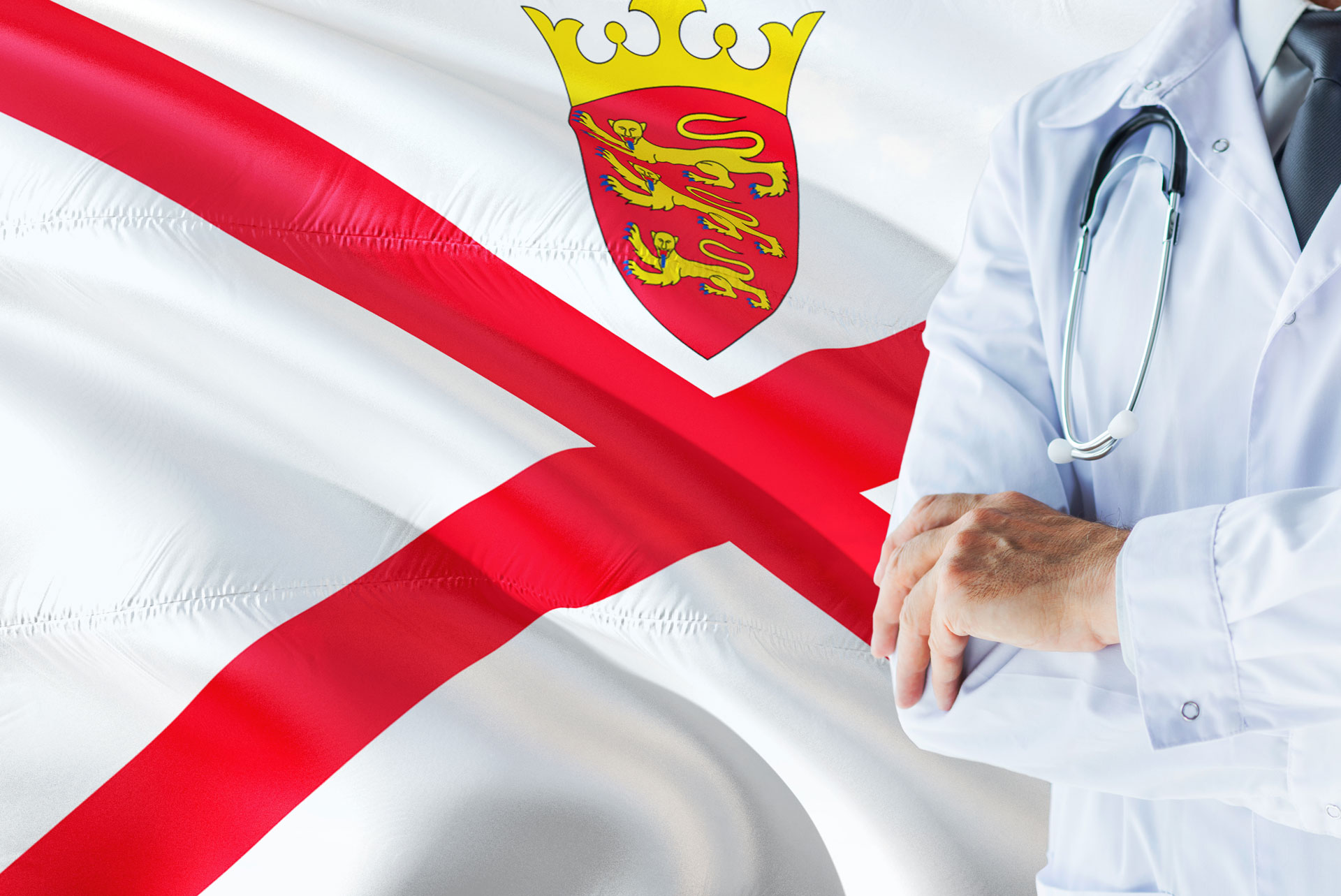 Doctor with stethoscope in front of Jersey flag